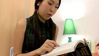 Asian babe doing her homework